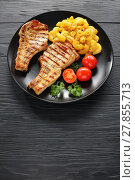 Купить «grilled pork chops with pasta on plate», фото № 27855713, снято 6 февраля 2018 г. (c) Oksana Zh / Фотобанк Лори