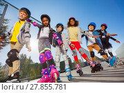 Купить «Happy kids rollerblading with hands like wings», фото № 27855781, снято 14 октября 2017 г. (c) Сергей Новиков / Фотобанк Лори
