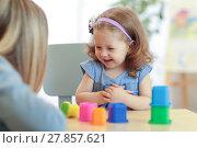 Купить «Mother and kid playing colorful block toys at home», фото № 27857621, снято 17 октября 2018 г. (c) Оксана Кузьмина / Фотобанк Лори