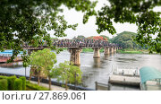Купить «Old bridge over the River Kwai on tilt shift is a historical attractions during World War 2 the famous of Kanchanaburi Province in Thailand,16:9 wide screen», фото № 27869061, снято 16 августа 2018 г. (c) PantherMedia / Фотобанк Лори
