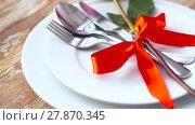 Купить «close up of red rose flower on set of dishes», видеоролик № 27870345, снято 13 февраля 2018 г. (c) Syda Productions / Фотобанк Лори