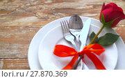 Купить «close up of red rose flower on set of dishes», видеоролик № 27870369, снято 10 февраля 2018 г. (c) Syda Productions / Фотобанк Лори