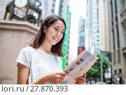 Купить «Woman finding the location on city map in Hong Kong», фото № 27870393, снято 19 февраля 2018 г. (c) PantherMedia / Фотобанк Лори