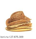 Купить «The lot of straw hats isolated on white background.», фото № 27875309, снято 15 декабря 2018 г. (c) PantherMedia / Фотобанк Лори