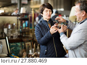 Купить «attentive mature spouses buying retro handicrafts on flea market», фото № 27880469, снято 23 октября 2017 г. (c) Яков Филимонов / Фотобанк Лори
