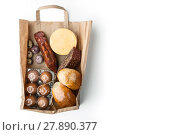 Купить «Food mix  inside a paper bag on the white background», фото № 27890377, снято 17 июня 2019 г. (c) PantherMedia / Фотобанк Лори