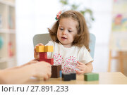 Купить «Little child girl plays in kindergarten in Montessori preschool class.», фото № 27891233, снято 19 сентября 2018 г. (c) Оксана Кузьмина / Фотобанк Лори