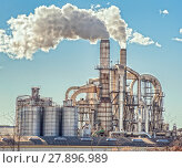 Купить «Chimneys and silos of a factory.», фото № 27896989, снято 14 июля 2018 г. (c) PantherMedia / Фотобанк Лори