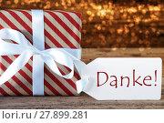Купить «Atmospheric Christmas Gift With Label, Danke Means Thank You», фото № 27899281, снято 26 мая 2019 г. (c) PantherMedia / Фотобанк Лори
