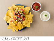 Купить «Vegetarian nachos with salsa and sour cream dips», фото № 27911381, снято 19 февраля 2020 г. (c) PantherMedia / Фотобанк Лори