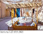Купить «Hanks of threads for production of traditional Uzbek handwork in the small bazaar, Khiva, Uzbekistan», фото № 27911961, снято 20 сентября 2015 г. (c) Куликов Константин / Фотобанк Лори