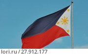 Купить «Flying bicolor flag of the Philippines with central golden sun representing the provinces and stars the islands», видеоролик № 27912177, снято 12 февраля 2018 г. (c) Mikhail Davidovich / Фотобанк Лори