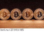 Four golden bitcoin coins. Стоковое фото, фотограф Anton Chechotkin / Фотобанк Лори