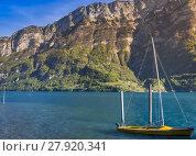 Купить «Boat with sails anchored on Walensee lake», фото № 27920341, снято 25 марта 2019 г. (c) PantherMedia / Фотобанк Лори