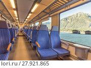 Купить «Train chairs and mountain view through the window», фото № 27921865, снято 20 февраля 2019 г. (c) PantherMedia / Фотобанк Лори