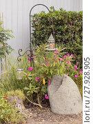 Купить «Birdhouse hangs from a garden hook », фото № 27928905, снято 28 мая 2018 г. (c) PantherMedia / Фотобанк Лори
