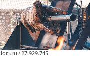 Купить «Whole bull carcass fried on spit on Medieval Fiesta in Besalu, Spain», видеоролик № 27929745, снято 27 сентября 2017 г. (c) Яков Филимонов / Фотобанк Лори