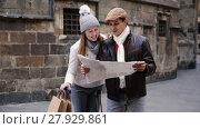 Купить «Smiling couple man and woman in the historic center with map in autumn», видеоролик № 27929861, снято 27 ноября 2017 г. (c) Яков Филимонов / Фотобанк Лори