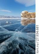 Купить «Lake Baikal in the winter. Beautiful blue ice with a thickness of almost a meter covers the Small Sea (Maloye More). Focus on the texture of ice», фото № 27934681, снято 11 февраля 2018 г. (c) Виктория Катьянова / Фотобанк Лори