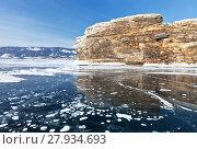Купить «Frozen Baikal Lake in February sunny day. Beautiful ice blue with white bubbles near the rocks of the Ogoy Island», фото № 27934693, снято 11 февраля 2018 г. (c) Виктория Катьянова / Фотобанк Лори