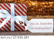 Купить «Atmospheric Gift With Label, Weihnachten Means Christmas», фото № 27935281, снято 27 мая 2019 г. (c) PantherMedia / Фотобанк Лори