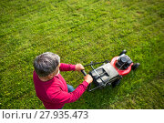 Купить «Senior man mowing his garden - shot from above - interesting angle view», фото № 27935473, снято 18 августа 2018 г. (c) PantherMedia / Фотобанк Лори