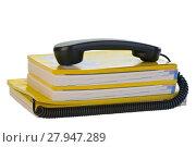 Купить «telefonhoerer with phonebook», фото № 27947289, снято 22 апреля 2019 г. (c) PantherMedia / Фотобанк Лори