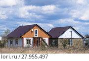 Купить «The roof of corrugated sheet on the houses», фото № 27955497, снято 26 мая 2019 г. (c) PantherMedia / Фотобанк Лори