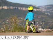 Купить «Little Boy Riding Wooden Bike», фото № 27964397, снято 19 августа 2019 г. (c) PantherMedia / Фотобанк Лори