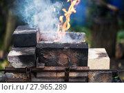 Купить «flame in outdoor rural brick forging furnace», фото № 27965289, снято 20 марта 2018 г. (c) PantherMedia / Фотобанк Лори