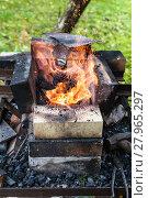 Купить «iron rod is heated in brick forging furnace», фото № 27965297, снято 19 марта 2018 г. (c) PantherMedia / Фотобанк Лори