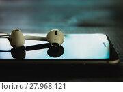 Купить «close up headphone stack on phone in black color tone, new headphone modern design device of phone technology», фото № 27968121, снято 18 марта 2018 г. (c) PantherMedia / Фотобанк Лори