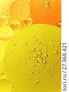 Купить «Yellow and orange oil droplet on water», фото № 27968421, снято 20 апреля 2018 г. (c) PantherMedia / Фотобанк Лори
