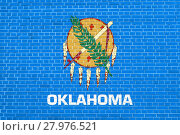 Купить «Flag of Oklahoma on brick wall texture background», фото № 27976521, снято 19 октября 2018 г. (c) PantherMedia / Фотобанк Лори