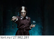 Купить «The Halloween theme: crazy girl with snakes», фото № 27982281, снято 25 марта 2019 г. (c) PantherMedia / Фотобанк Лори