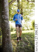 Купить «young man jogging at the woods», фото № 27996217, снято 24 июля 2019 г. (c) PantherMedia / Фотобанк Лори