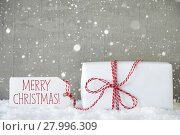 Купить «Gift, Cement Background With Snowflakes, Text Merry Christmas», фото № 27996309, снято 20 января 2019 г. (c) PantherMedia / Фотобанк Лори