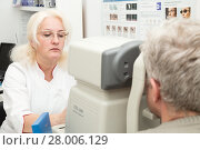 Купить «The ophthalmologist examines the vision of a mature man on a diagnostic equipment refkeratometer», фото № 28006129, снято 13 февраля 2018 г. (c) Юлия Бабкина / Фотобанк Лори