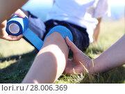 Купить «mother provides children knee elastic bandage.», фото № 28006369, снято 24 февраля 2018 г. (c) PantherMedia / Фотобанк Лори