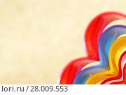 Купить «Абстрактный яркий разноцветный радужный прямоугольный бежевый фон с волнистыми линиями разных оттенков  в форме сердца», фото № 28009553, снято 18 февраля 2018 г. (c) Светлана Евграфова / Фотобанк Лори