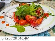 Купить «Baked tomatoes and peppers with Greens», фото № 28010461, снято 16 февраля 2019 г. (c) PantherMedia / Фотобанк Лори