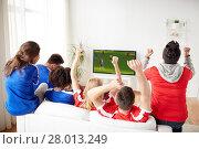Купить «friends or soccer fans watching game on tv at home», фото № 28013249, снято 14 августа 2016 г. (c) Syda Productions / Фотобанк Лори