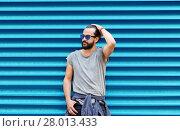 Купить «man in sunglasses posing over ribbed blue wall», фото № 28013433, снято 2 июня 2016 г. (c) Syda Productions / Фотобанк Лори