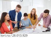 Купить «creative team with blueprint working at office», фото № 28013929, снято 27 февраля 2016 г. (c) Syda Productions / Фотобанк Лори