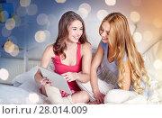 Купить «happy friends or teen girls with tablet pc at home», фото № 28014009, снято 14 ноября 2015 г. (c) Syda Productions / Фотобанк Лори