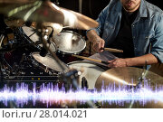 Купить «drummer playing drum kit at sound recording studio», фото № 28014021, снято 18 августа 2016 г. (c) Syda Productions / Фотобанк Лори