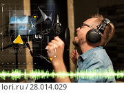 Купить «man with headphones singing at recording studio», фото № 28014029, снято 18 августа 2016 г. (c) Syda Productions / Фотобанк Лори