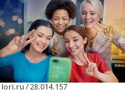 Купить «happy young women taking selfie with smartphone», фото № 28014157, снято 12 февраля 2015 г. (c) Syda Productions / Фотобанк Лори
