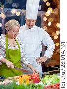 Купить «happy male chef cook with woman cooking in kitchen», фото № 28014161, снято 12 февраля 2015 г. (c) Syda Productions / Фотобанк Лори