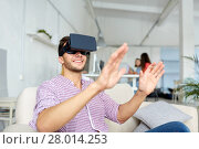 Купить «happy man with virtual reality headset at office», фото № 28014253, снято 27 февраля 2016 г. (c) Syda Productions / Фотобанк Лори
